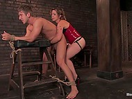 Imperious chick forced young man to beg for mercy while roughly spanking him in basement