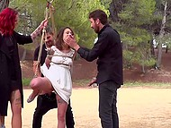 Petite girl willingly allowed two bearded man to tie her to tree and fuck from both sides