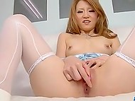 Petite Japanese lady in seductive lingerie sets vibrator in motion and reaches strong orgasm in solo video