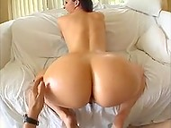 Long-haired Brazilian sexpot lets lucky dude squeeze her huge oiled butt cheeks