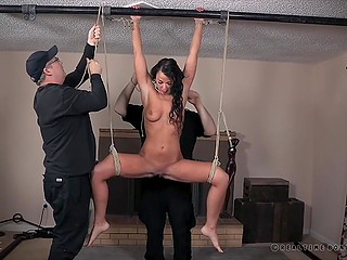 Dame with two men took off black lingerie of delicate brunette and spanked her using whip