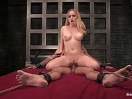 Imperious blonde enjoys her supremacy while riding the big cock of tied up muscular dude