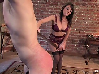 Imperious beauty in sexy lingerie tied up and slowly spanked muscled guy's butt