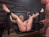 After spanking tied-up MILF with big tits, gym rat slowly penetrates her little butthole