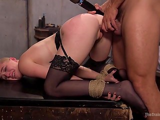 Specialist in BDSM games tied chesty slave up and fucked her from behind after spanking with flogger