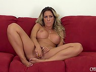 Full-bosomed MILF with curly hair passionately thrusts vibrator into beautiful vagina alone 4