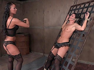 Brunettes in high heels grabbed whip and ropes to receive thrills in basement