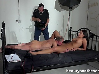 While filming adult scene, operator has to show by his own example how granddad should satisfy tall brunette