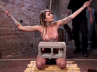 Dominant man wasn't satisfied after attaching clothespins on captive's body and he put stone block on her knees
