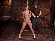 Tied up lass was riding cock until man in cap helped her to stand up and guy came over face