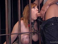 Man took gag from mouth of red-haired captive but a moment later his dick flew there