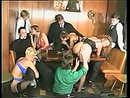 Regular visitors of a bar fuck big-tittied waitresses on tables and on bar stage in vintage porn movie