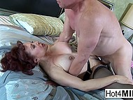 Big-tittied MILF teased bald man's cock with feet and he fucked neat pussy in missionary 11
