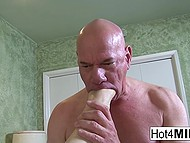 Big-tittied MILF teased bald man's cock with feet and he fucked neat pussy in missionary 5