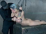 Dominant man gently slapped busty ash-haired woman with metallic rod and tied her up