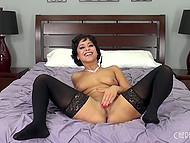 Short-haired Latina in black stockings makes great show of delicious body