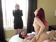 Sexy red-haired girl has sex with handy fucker in bedroom in front of blonde MILF 9