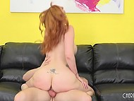 Ravishing redhead with awesome tits gets her trimmed twat rammed on the black couch 7