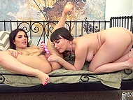 Provocative brunettes made themselves comfortable on bed and made trimmed pussies soaked wet