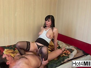 Insatiable lady in black stockings started to service hard penis and gladly tasted thick sperm