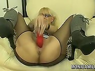 Big-boobied pornstar from Norway Monica Milf tears her pantyhose to dildo excited vagina 10