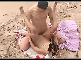 Voyeur is on the right beach in right time to record shameless couple doing it on sand
