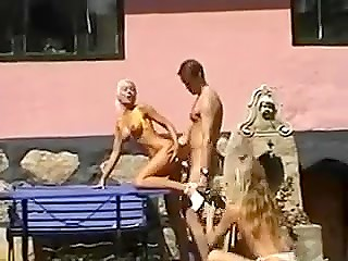 Dude fucks big-boobied Danish blonde on the porch while her naked girlfriend is taking photos