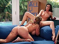 Big-boobied dame and slender brunette were passionately having fun on blue couch