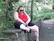 Fatty woman from England flashes boobs and huge buttocks walking through public garden