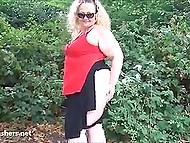 Fatty woman from England flashes boobs and huge buttocks walking through public garden 4