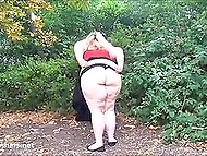 Fatty woman from England flashes boobs and huge buttocks walking through public garden 8