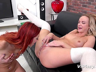 Red-haired lesbian girl tastes pissing of her blonde girlfriend without many words