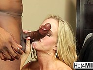 Blonde-haired MILF intrigued spectators with solo scene and had interracial coition 11