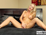 Blonde-haired MILF intrigued spectators with solo scene and had interracial coition 4