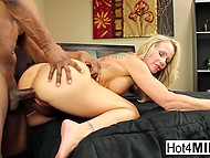 Blonde-haired MILF intrigued spectators with solo scene and had interracial coition 6