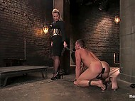 Imperious female with huge breasts closes pumped guy in dungeon and uses his cock as her thing