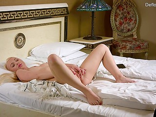 White-headed sweetie with ponytails made herself comfortable on bed and slowly caressed shaved cunny