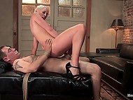 Cheerful blonde penetrated tied up man's asshole with strapon before taking ride on hard cock