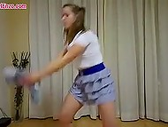 Strong butt cheeks are seen under teenage girl's short skirt during workout with plush toy 9