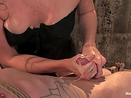 Red-haired girl in fashioned lingerie spanked tied up dude with whip and even helped him to cum 11