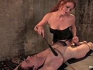 Red-haired girl in fashioned lingerie spanked tied up dude with whip and even helped him to cum 6