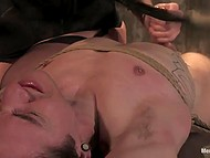 Red-haired girl in fashioned lingerie spanked tied up dude with whip and even helped him to cum 8