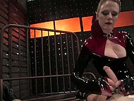 Ruthless dame in black outfit doesn't let tied up male to relax in torture room
