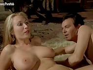 Actor touches big natural breasts and hairy pussy of beautiful blonde in fragment of vintage Italian movie