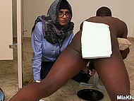Young Arab female with glasses weights white and black cock before handling them by turns 11
