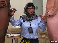 Young Arab female with glasses weights white and black cock before handling them by turns 3