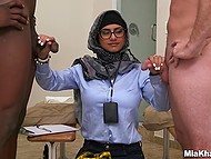 Young Arab female with glasses weights white and black cock before handling them by turns 4