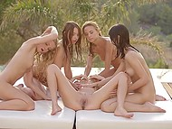 Naked girls oiled each other's slim body and gently stimulated twats before swimming in pool