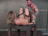 Woman laughs being chained in dungeon but smile leaves her face when dominants start fucking her hard 10