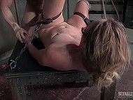 Woman laughs being chained in dungeon but smile leaves her face when dominants start fucking her hard 11